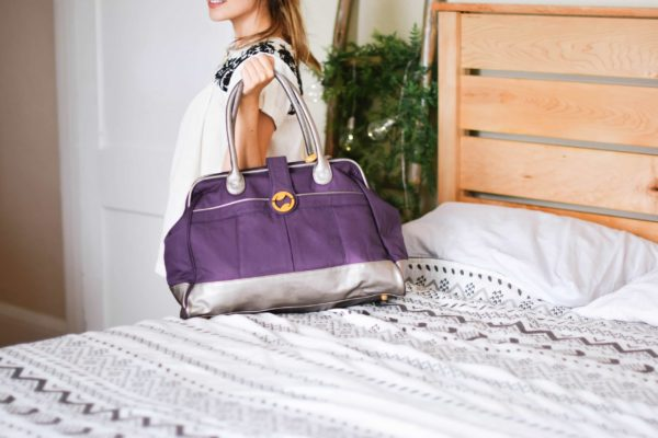 travel bags for women, available in purple, gray, and olive green