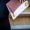 gray clutch with brown vegan leather, sustainable and cruelty free