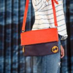 purple crossbody bag with red vegan leather