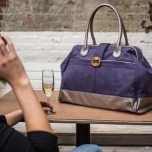 purple canvas weekend bag with metallic trim | @canopyverde