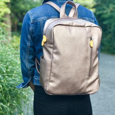 rose gold vegan leather backpack