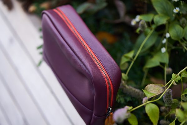 cosmetics bag in burgundy red